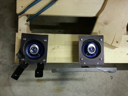 Plates and brackets fabricated to fit speakers under dash of Pontiac GTO